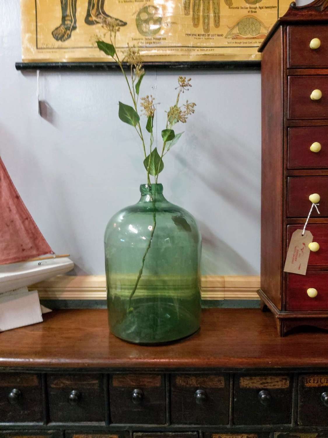 Large antique French hand blown green glass bottle